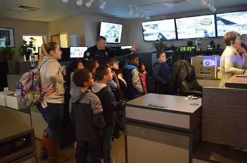 Elementary tour of the communications center led by an officer
