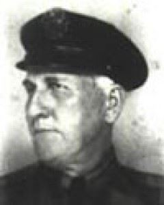 an image of patrolman sonny vaughn in uniform, black and white