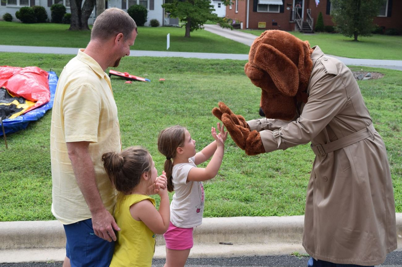 NNO McGruff high fives child
